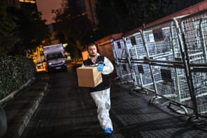 A Turkish forensic police officer carries a box at the Saudi Arabian consulate.
