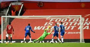 Everton goalkeeper Olsen seems to lose his footing as he fails to save McTominay's header.