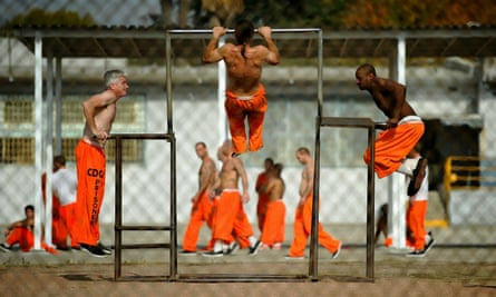 Inmates at Chino state prison exercise in the yard.