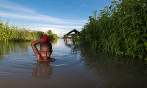 A child in the flood-affected area of Lalmonirhat, Bangladesh, in 2017. What we're deciding now is what life will be like for the kids born this year who will be 82 in the year 2100.
