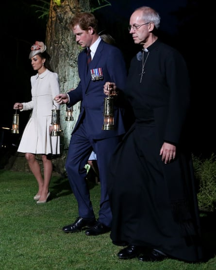 With the Duchess of Cambridge and Prince Harry during a ceremony at St Symphorien Military cemetery, Mons, Belgium, in 2014.