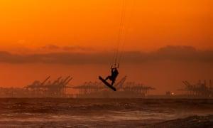 Kite surfing in Huntington Beach, California, yesterday.