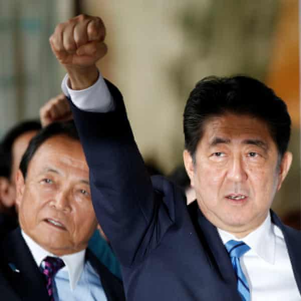 Japan's PM Shinzō Abe raises his fist after calling a snap election.