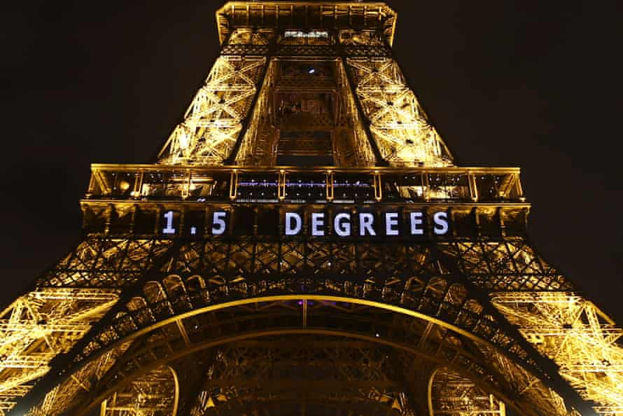 The slogan '1.5 degrees' is projected on the Eiffel Tower for Cop21 in 2015