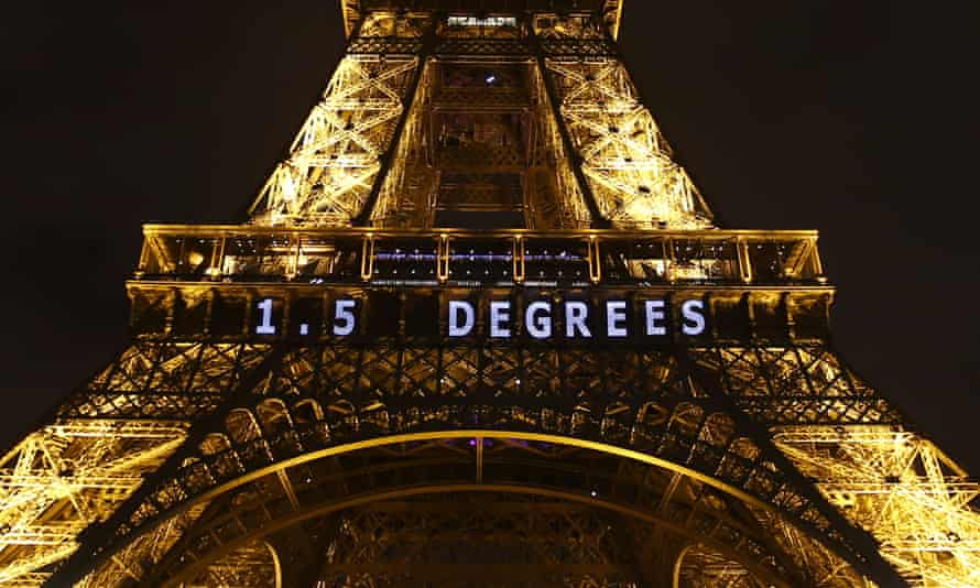 The Eiffel tower lit up during the Paris climate talks, referencing the 1.5C target that governments have agreed to pursue efforts to hold temperatures to