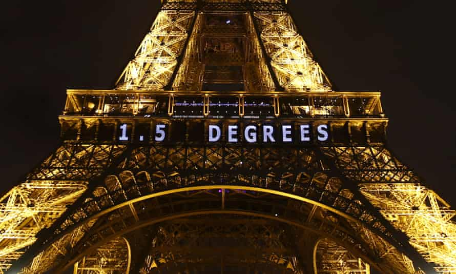 The climate change target of 1.5 degrees is projected on the Eiffel Tower during the UN's 2015 Paris climate summit.