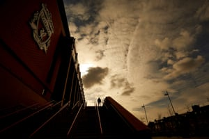 19 March – A visitor taking photographs outside Liverpool FC's Anfield stadium where the team were due to play Crystal Palace