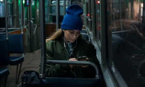 Young woman riding in public transportation by night