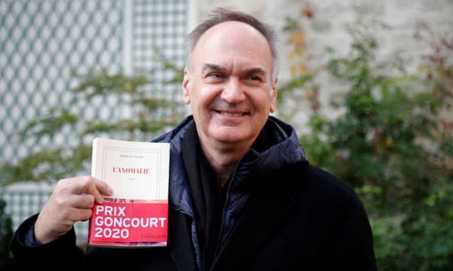 Hervé Le Tellier poses at his publishing house Gallimard after winning the Prix Goncourt for L'Anomalie.