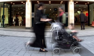 Woman pushing child in buggy