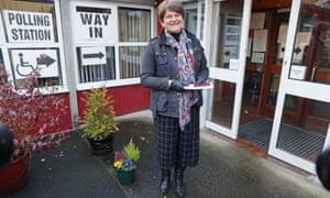 DUP leader Arlene Foster arrives at a polling station in Enniskillen