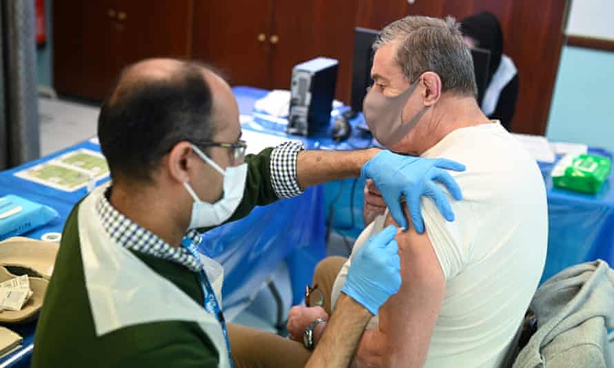 A pharmacist administers a vaccine dose in Birmingham.