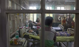 People suffering from fever, one of the main symptoms of several mosquito-borne diseases, at a hospital in New Delhi, India.