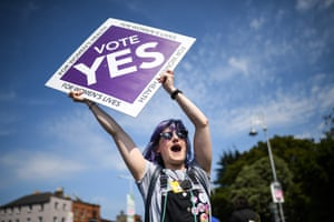 A supporter of the yes campaign holds a placard in Dublin