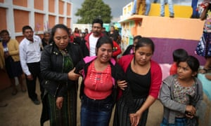 The family of a girl who died at Hogar Seguro mourn in the village of Yerbabuena, Guatemala