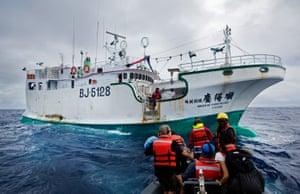 Greenpeace activists prepare to board illegal fishing vessel Shuen De Ching No 888.
