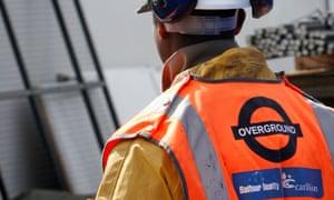the Carillion logo adorns the orange bib of a London Overground construction worker