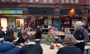 As bars reopened on Saturday, the Northern Quarter set out tables for customers on the closed road.