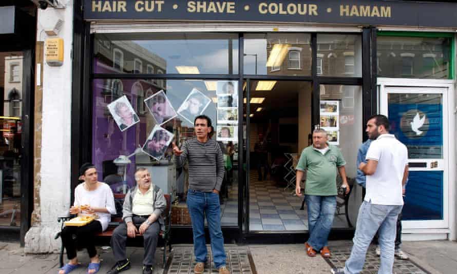 Turkish men outside barber's shop in Dalston, London