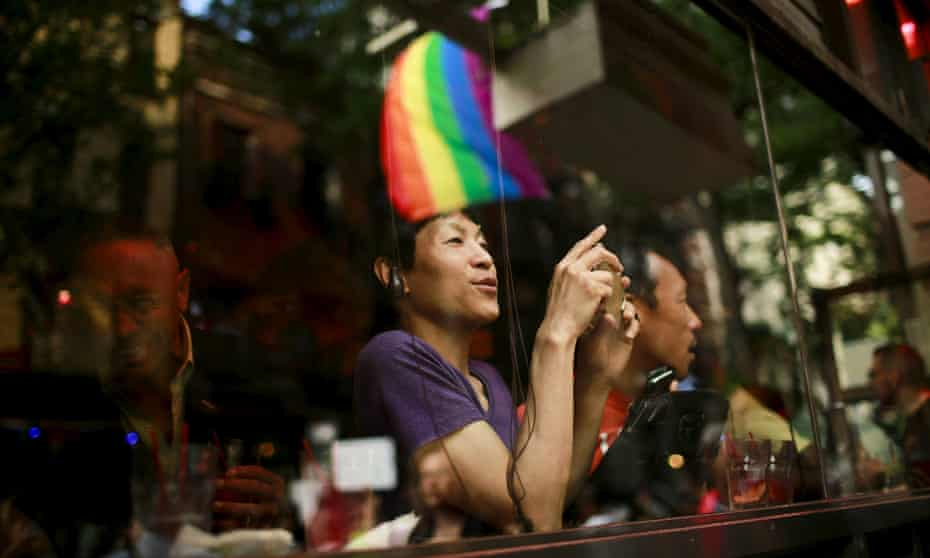 A man in Greenwich Village watches celebrations after the US Supreme Court approved same-sex marriage in June 2015.
