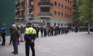 People line up outside a polling station to cast their vote for the general election in Barcelona, Spain, Sunday, April 28, 2019.