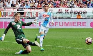 The Torino goalkeeper Joe Hart kicks the ball past Napoli's José Callejón during the Serie A match.