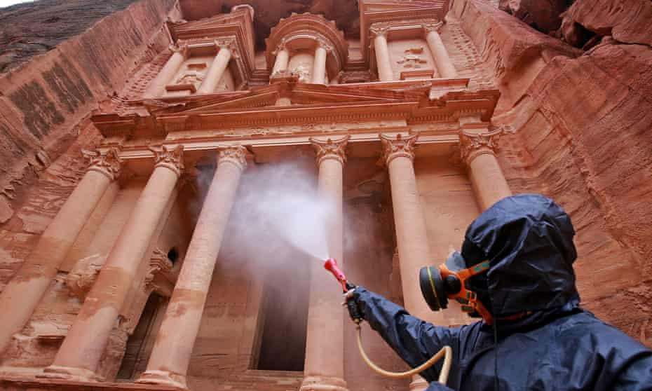 A worker disinfects monuments in Jordan's archaeological city of Petra to prevent the spread of coronavirus.