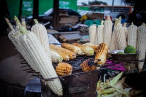 Corn on the cob roasted on charcoal burners is for sale on most of the main lanes of Kibera. As the number of people coming into Kibera grows, stallholders complain that increasing competition is making business tougher