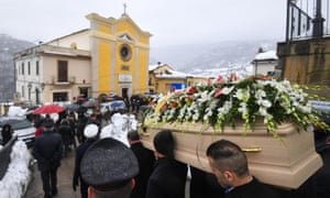 The coffin of Alessandro Giancaterino, one of the victims of the avalanche, is carried to the San Nicola church in Farindola.