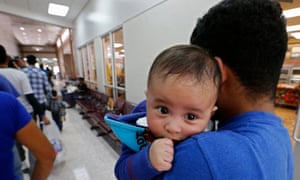Migrant families about to be processed in Texas.