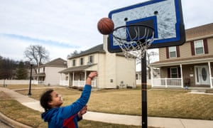 Mya Womack shoots baskets outside her home in the Spring Grove subdivision.