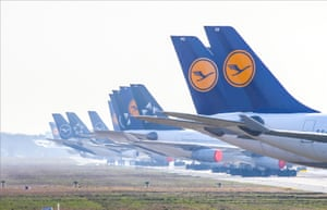 The engines of Lufthansa planes are covered with plastic foil at Frankfurt airport.