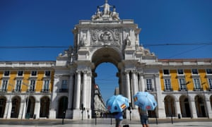 Tour guides await customers in Lisbon, Portugal