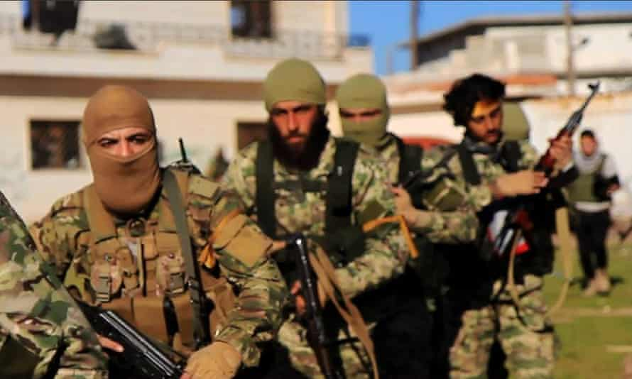 Fighters from Syria's al-Qaida-linked al-Nusra front. Panorama claims the branch handpicked police officers for two stations in Idlib province.