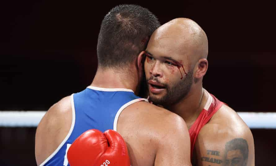 A bloodied Frazer Clarke with France's Mourad Aliev