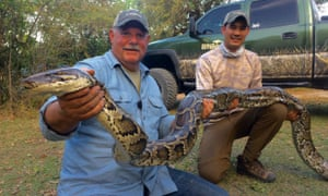 Bill Booth with one of the Burmese pythons wreaking havoc upon the Everglades' fragile ecosystem.