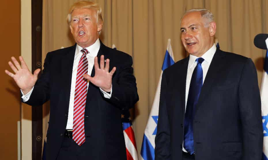 Donald Trump, in Israel with prime minister, Benjamin Netanyahu, where he criticised Iran.