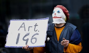 A protestor wearing an interesting mask is seen in Berlin during a protest against measures the German government has taken against the novel coronavirus. April 25, 2020. Credit: Abdulhamid Hosbas/Anadolu Agency