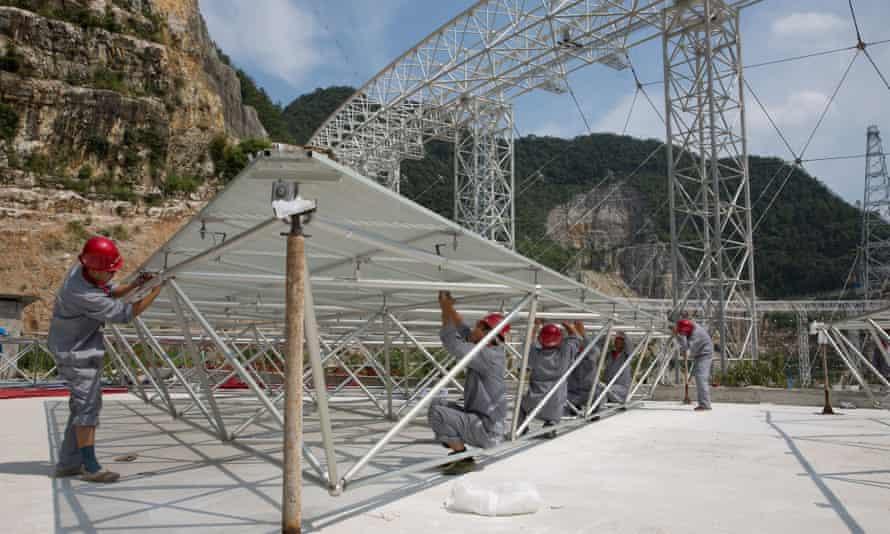 Technicians work at the assembly site telescope