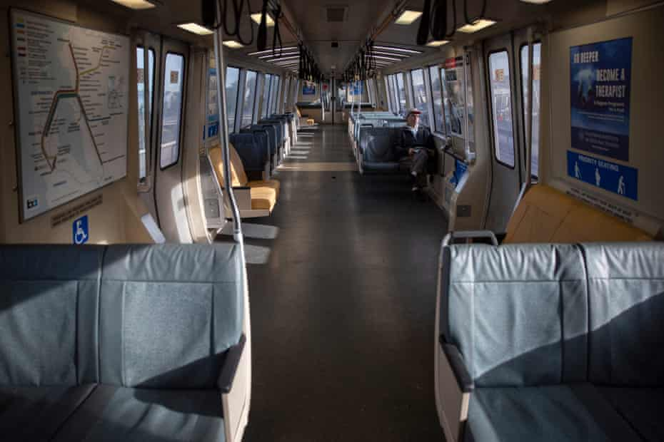A lone commuter rides the normally packed San Francisco-bound Bart train.