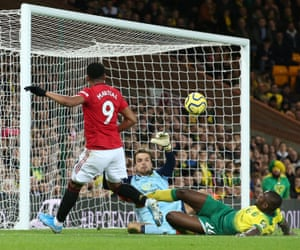 Anthony Martial of Manchester United beats Tim Krul in the Norwich goal.