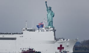 The USNS Comfort, a 1,000-plus bed Navy medical ship, sails past the Statue of Liberty in New York, 30 March 2020.