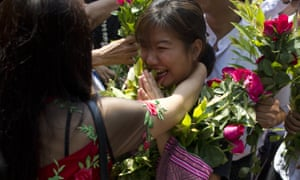 Family members welcome a student protester as she arrives for the hearing in Tharrawaddy.