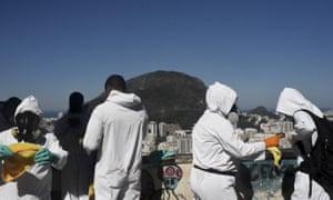Sanitary staff prepare to disinfect against coronavirus in the Santa Marta Favela near Rio de Janeiro, Brazil.