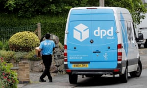 A DPD delivery driver takes a parcel from his van in Shepshed, UK