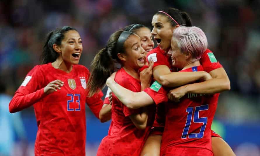 Alex Morgan hugs Megan Rapinoe on a brilliant night for the World Cup holders.