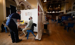 A member of the public prepares to receive a dose of the AstraZeneca/Oxford Covid-19 vaccine at City Hall in Hull.