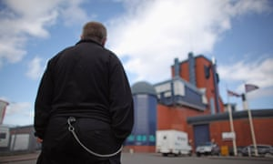A prison officer stands outside Birmingham prison in Winson Green.