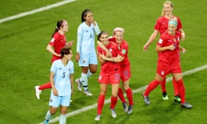 Alex Morgan of the US celebrates scoring their fifth goal with teammates.