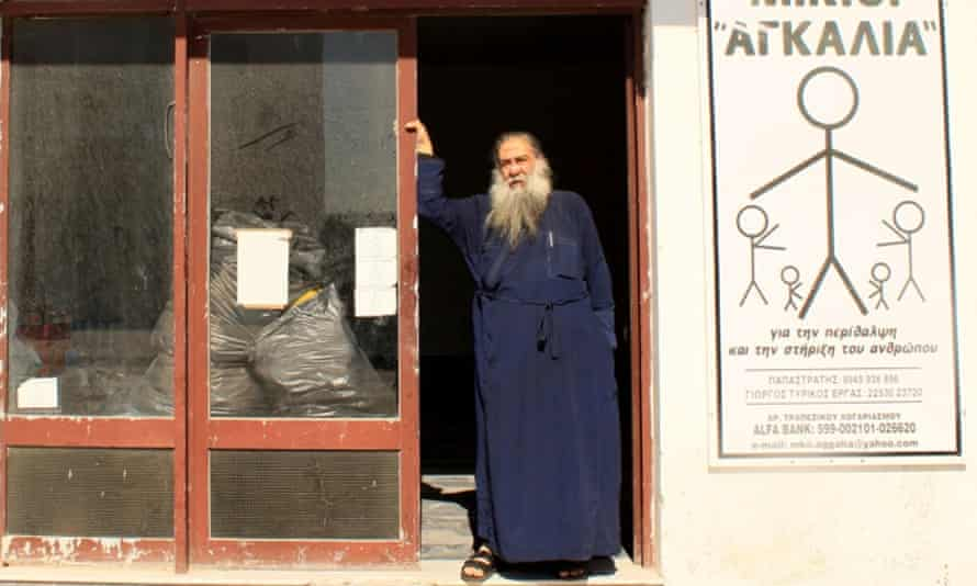 Father Stratis Dimou, a Greek Orthodox priest on the island of Lesbos, at the charity he founded to help refugees and migrants.